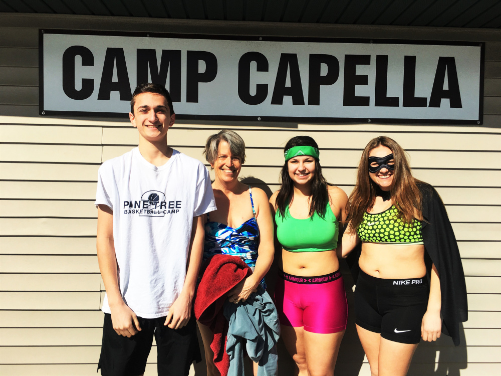 Three Hall-Dale High School students and their faculty advisor recently took part in the school's Key Club Polar Plunge for Camp Capella. From left are Anthony Romano, Advisor Lydia Leimbach, Kaylee Bickford and Sierra Millay.