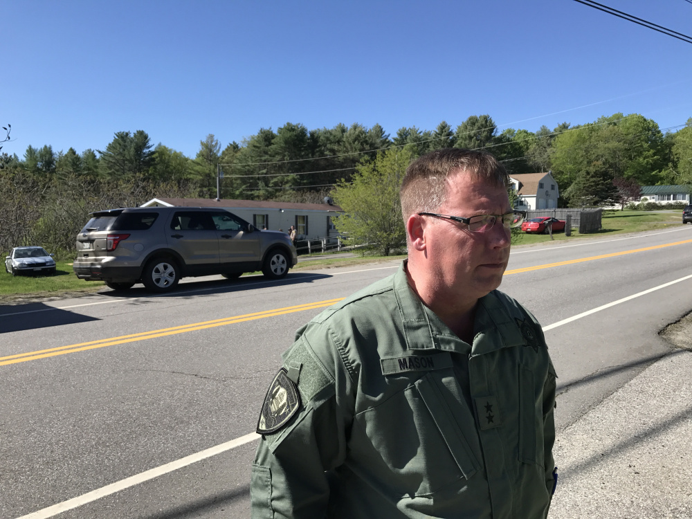 Ken Mason, Kennebec County sheriff, speaks Saturday morning outside the Belgrade home where one person was killed and one was injured in an officer-involved shooting the previous night.