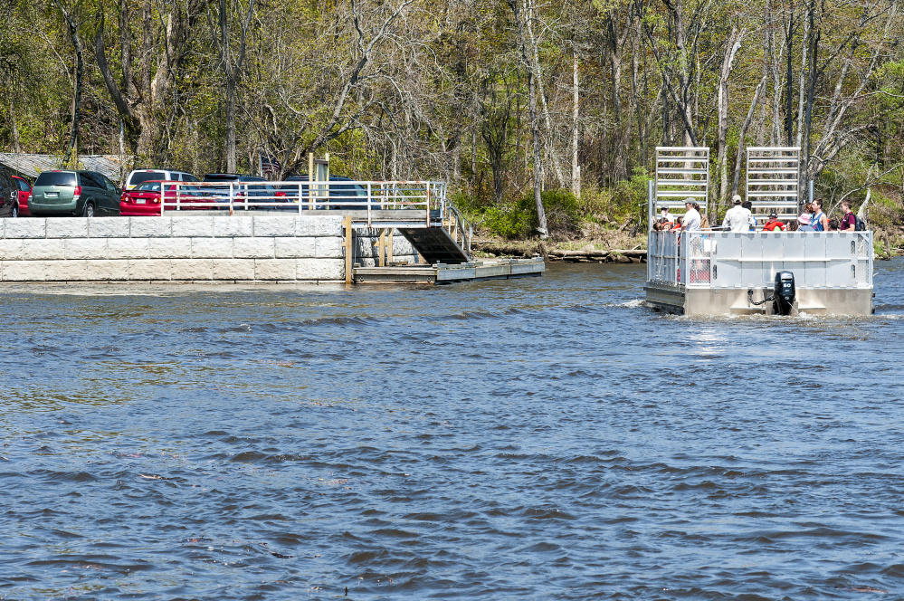 Swan Island Ferry carries a group of home-school students back to the new docking area from a visit to the island Wednesday on the shore of Kennebec River in Richmond.