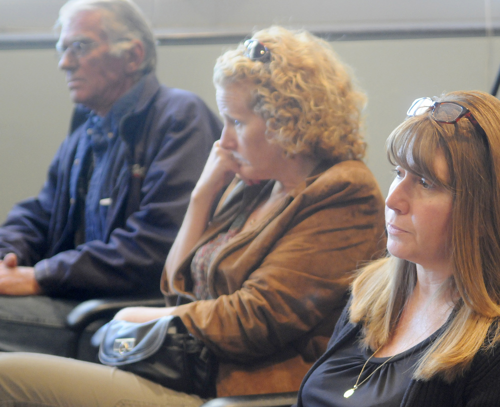 "Friends and relatives of three people killed in a 1996 car crash listen to testimony on Sept. 26, 2016, by Bryan Carrier at the Bureau of Motor Vehicles in Augusta where Carrier asked to have his driver's license restored. Carrier was convicted of manslaughter in the accident and his driving privileges revoked for life. From left are Royce ""Butch"" Jewell, who lost his wife, Arlyce, and 10-year-old son, Alex, in the crash; Jewell's partner, Tanya Morris, of Canaan; and Tracey Rotondi, of Athens, the daughter of Jewell and Arlyce and sister of Alex."
