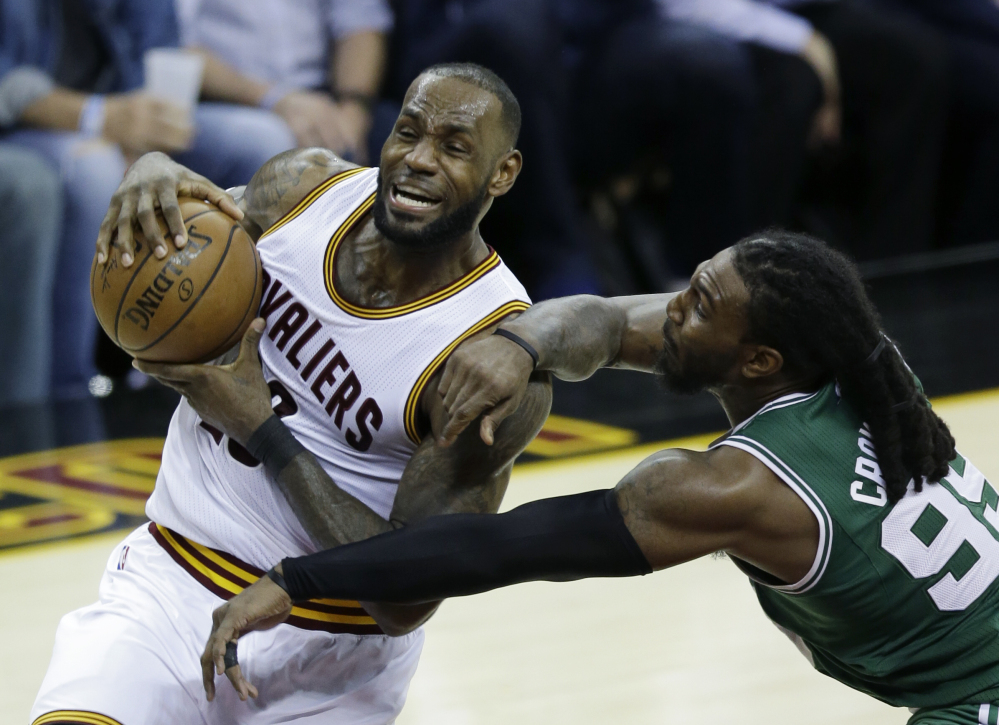 Cleveland Cavaliers forward LeBron James (23) goes up for a shot against Boston defender Jae Crowder during the second half of Game 4 of the Eastern Conference finals Tuesday.