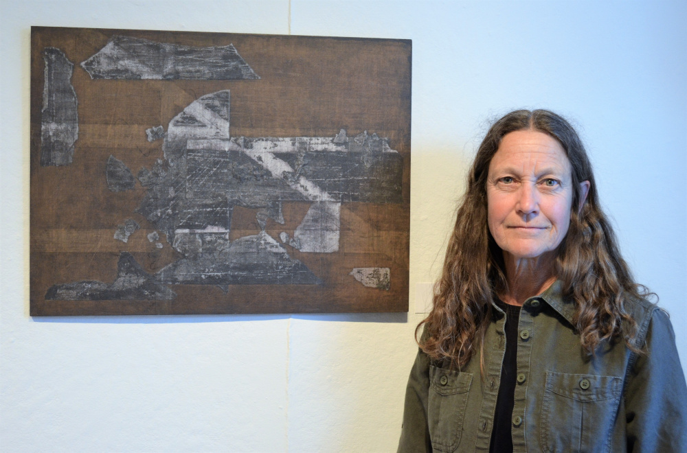 "Second Place was awarded to Nancy Bixler, of Hallowell, for her graphite mixed media piece titled ""Invisible Cities II."""