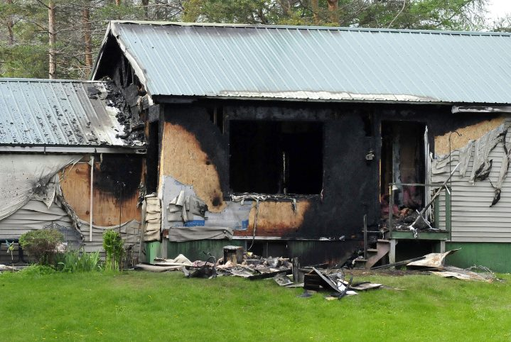 "The rear section of Sumner ""Bud"" Jones' home on Peltoma Avenue in Pittsfield sustained extensive fire damage Tuesday."