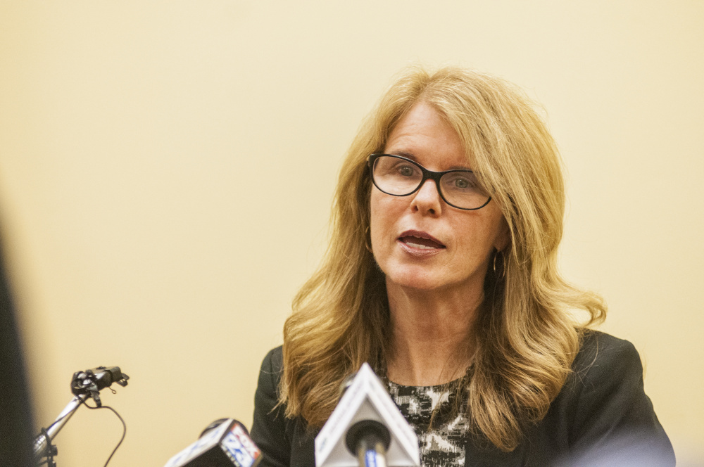 AUGUSTA, ME - MAY 24: Health and Human Services Commissioner Mary Mayhew reads a statement to reporters on Wednesday May 24, 2017 at the department headquarters in Augusta. She took no questions during the brief news conference about her departure from the DHHS. (Staff photo by Joe Phelan/Staff Photographer)