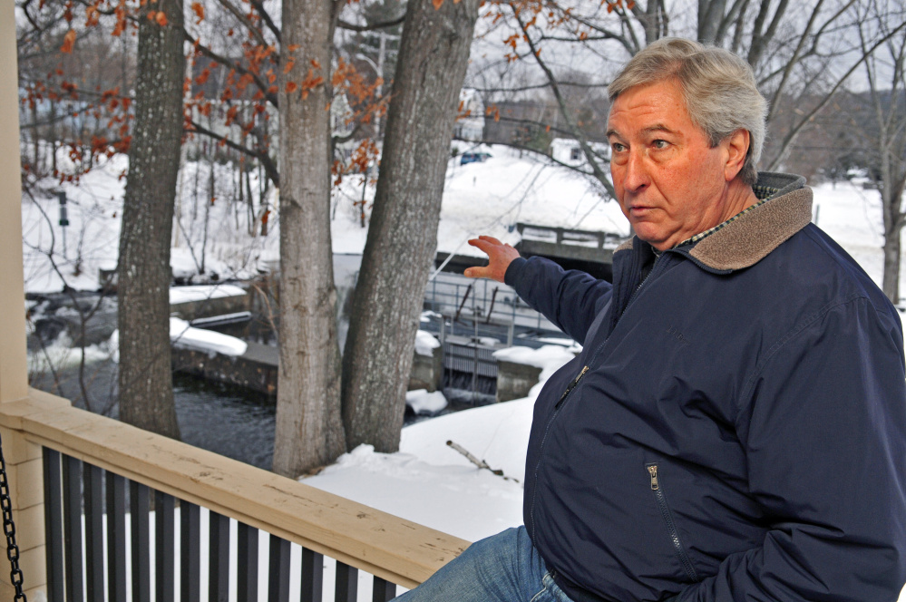 Tom Heiss talks in February about construction plans at the Maranacook Lake dam in Winthrop.