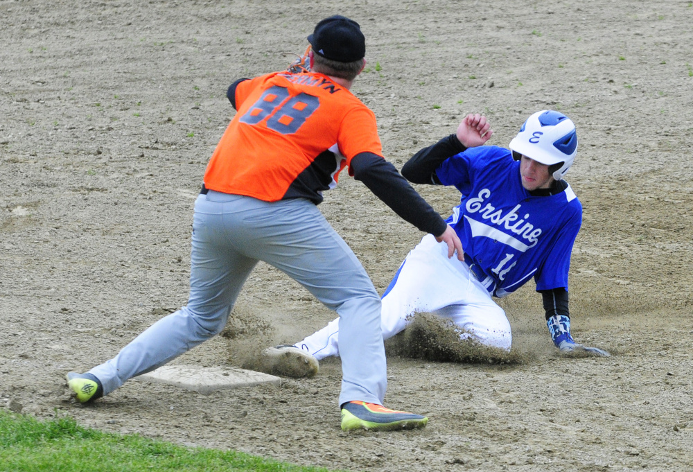 Erskine baserunner Chandler Moore slides safely into third base to beat the throw to Gardiner third baseman Sam Jermyn during a game Tuesday in Gardiner.