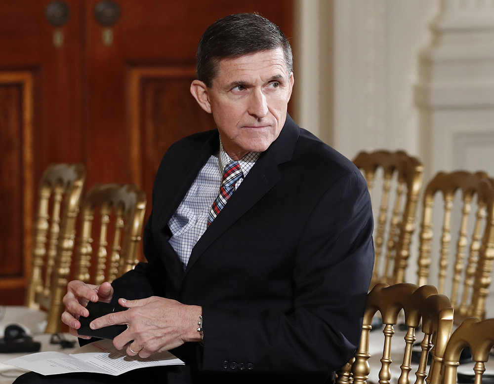 Then-National Security Adviser Michael Flynn sits in the East Room of the White House on  Feb. 10, 2017.  President Barack Obama warned Donald Trump against hiring Michael Flynn as national security adviser during an Oval Office meeting in the days after the 2016 election, according to three former Obama administration officials.