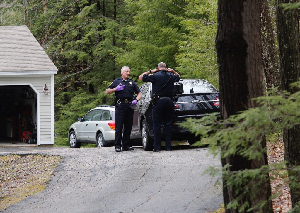Falmouth Lt. John Kilbride, left, speaks with Officer Steve Hamilton as they investigate a shooting on Poplar Ridge Drive in Falmouth on Tuesday.