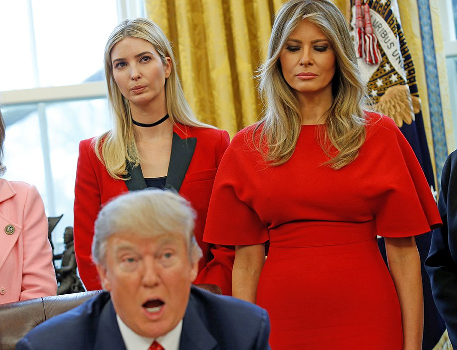 Melania and Ivanka Trump listen as the president peaks before signing H.R. 321 – a bill directing NASA to encourage women and girls to study science, technology, engineering, and mathematics, pursue careers in aerospace, and advance the nation's space science and exploration efforts – in the Oval Office on Feb. 28, 2017.