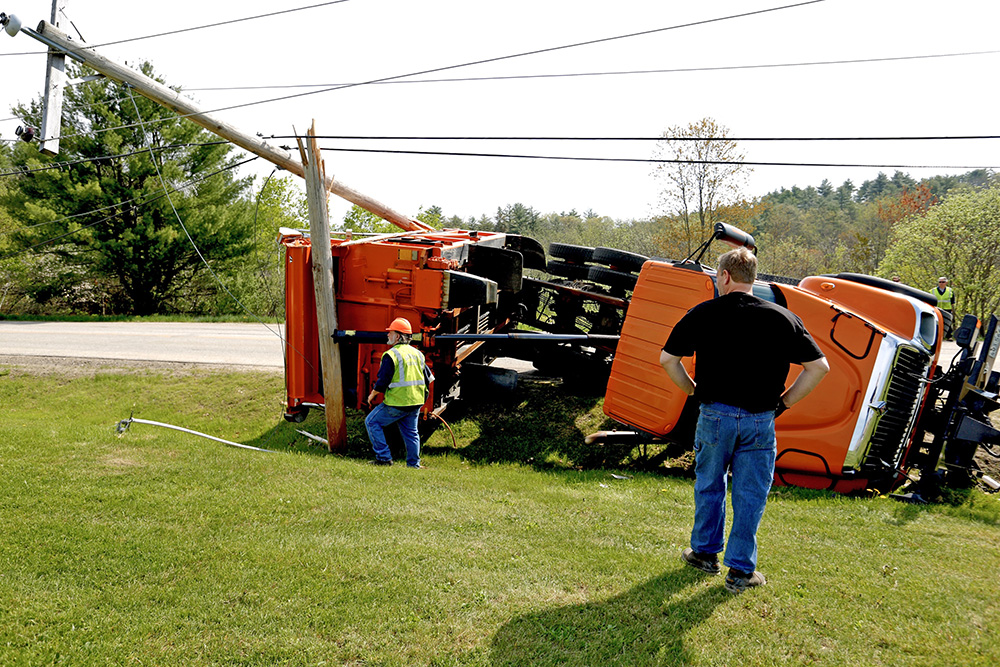Don Roberts, left, of Westbrook public services, and Brian Beaulieu, driver for B&B Towing, are at the crash scene on Gorham Public Works Drive Thursday morning.