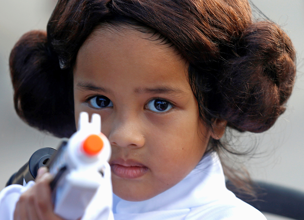 Leia Farid, 4, takes part in activities to mark Star Wars Day at Gardens by the Bay in Singapore Thursday.
