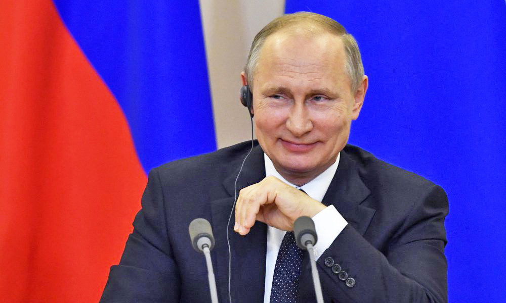 "Russian President Vladimir Putin listens to a question at a joint news conference with Italian Prime Minister Paolo Gentiloni at the Bocharov Ruchei state residence in the Russian Black Sea resort of Sochi on Wednesday. Putin has dismissed the ongoing scandal around President Trump sharing classified intelligence with Russian officials as ""political schizophrenia."""