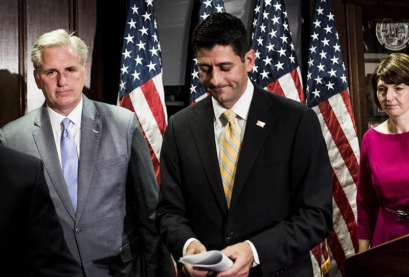 Speaker of the House Paul Ryan, center, and House Majority Leader Kevin McCarthy, left, talk to the press on Wednesday, May 17.