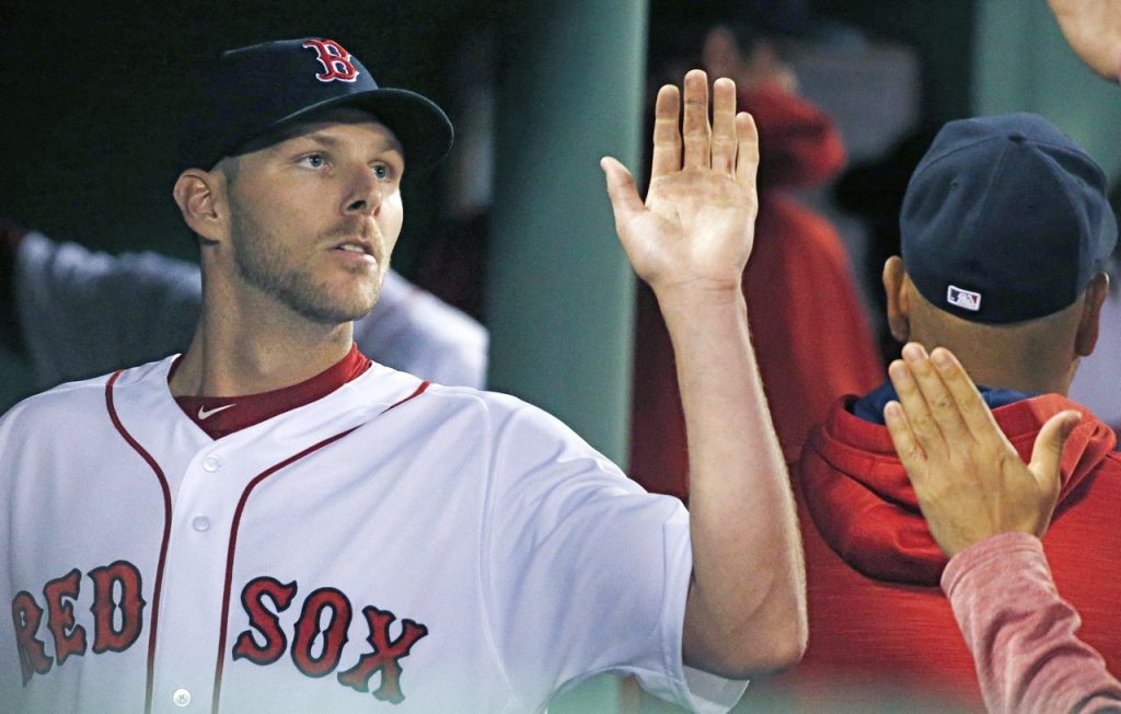 Chris Sale, who pitched through eight innings and notched a 5-2 win over the Orioles, is greeted in the dugout with high-fives Tuesday.