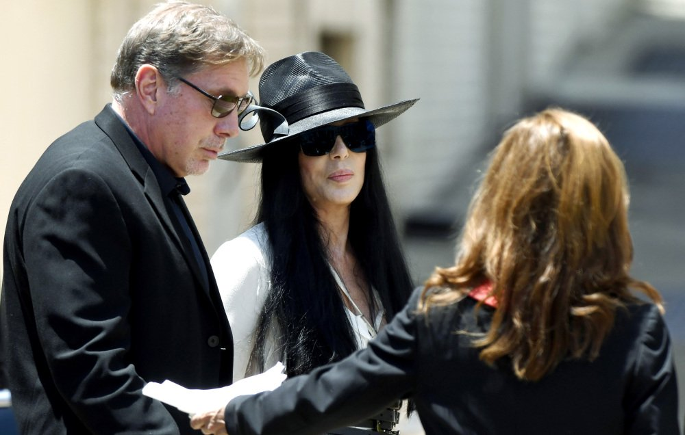 Cher, center, arrives Saturday at Snow's Memorial Chapel for the funeral of music legend and long-ago husband Gregg Allman.