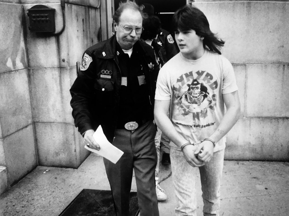 PORTLAND, ME - APRIL 19: Anthony Sanborn is led from Cumberland County Courthouse while waiting to be arraigned for murder of Jessie Briggs April 19, 1990. (Photo by Jack Milton/Staff Photographer)