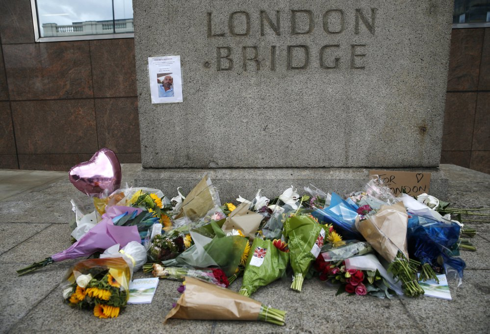 A floral tribute is seen in the London Bridge area Monday. Police arrested several people and are widening their investigation after a series of attacks described as terrorism killed several people and injured more than 40 others in the heart of London on Saturday.