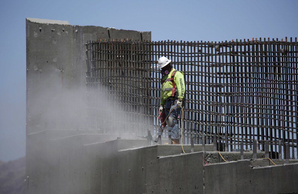 A man works on Interstate 11 near Boulder City, Nevada, last week. President Trump is planning a major push to promote a rebuilding of the nation's roads and bridges as his agenda has struggled in Congress and been overshadowed by White House controversies.