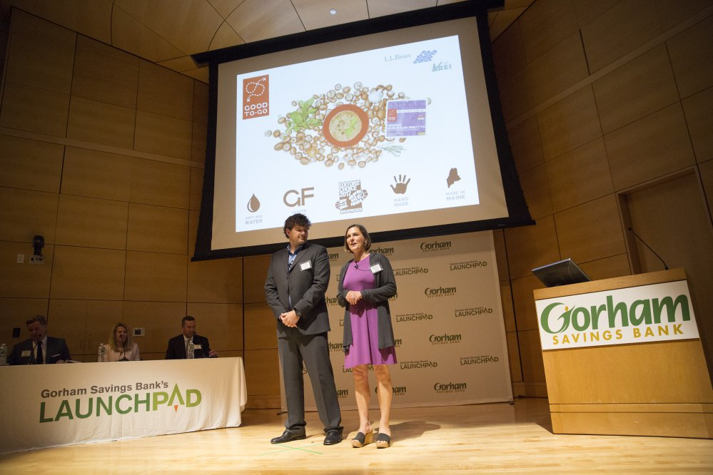 Jennifer Scism and David Koorits, owners of the Kittery business Good To-Go, make their seven-minute pitch Tuesday night at the LaunchPad competition at the University of Southern Maine in Portland. The husband-and-wife team won the $50,000 prize.