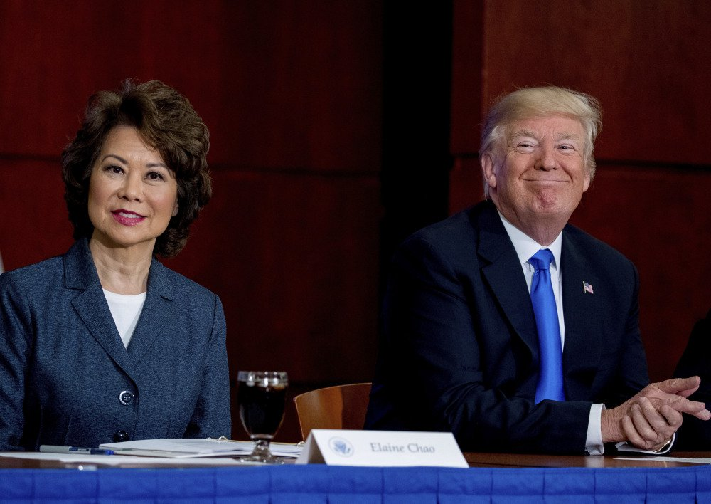 President Trump, with Transportation Secretary Elaine Chao, left, attends a roundtable on infrastructure at the Department of Transportation on Friday in Washington.