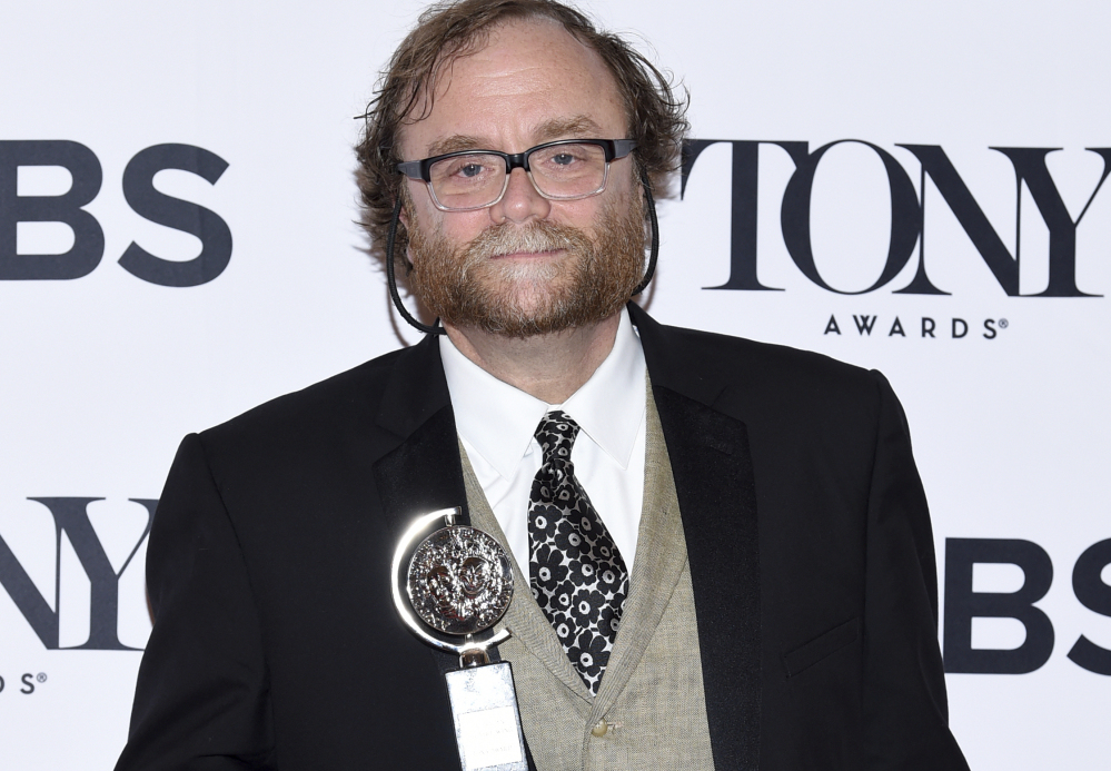 Christopher Akerlind holds his Tony Award for Best Lighting Design of a Play.