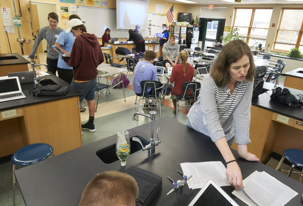 2017 file photo: Yarmouth science teacher Catie Wooten reviews a plan for a mock news conference as part of proficiency-based learning.