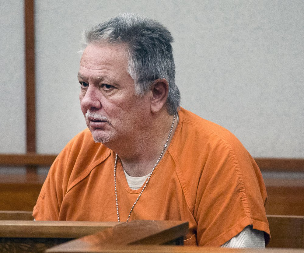 Prosecutors say Theodore Thomes threatened to have his neighbor declared incompetent if he didn't turn over $250,000 to Thomes.