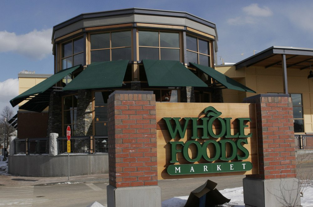 The Whole Foods Market in Portland as seen in 2007.  Online juggernaut Amazon announced Friday that it is buying Whole Foods in a deal valued at about $13.7 billion, including debt. Amazon.com Inc. will pay $42 per share of Whole Foods Market Inc.