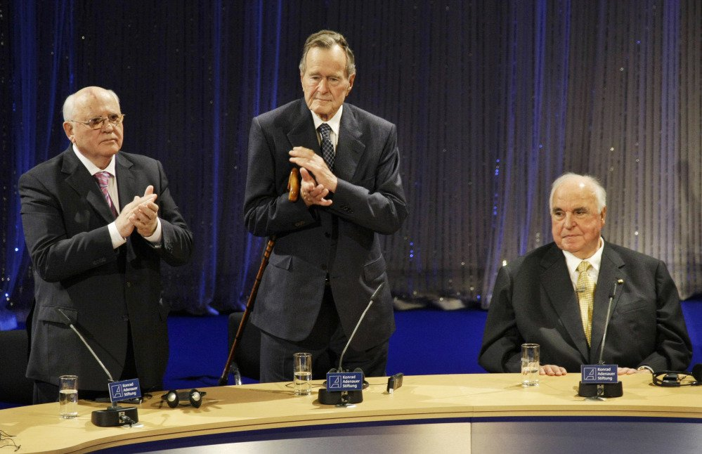 From left, the last Soviet leader, Mikhail Gorbachev, former U.S. President George H.W. Bush and former German Chancellor Helmut Kohl, applaud during an event in Berlin in 2009 to recall the crumbling of the Berlin wall on Nov. 9, 1989.