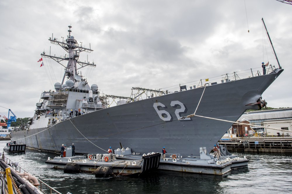 The Arleigh Burke-class guided-missile destroyer USS Fitzgerald (DDG 62) is shown pulling into a dry dock in Yokosuka, Japan, on June 15, 2016. The U.S. military says the Navy destroyer collided with a merchant ship off the coast of Japan and there have been injuries.