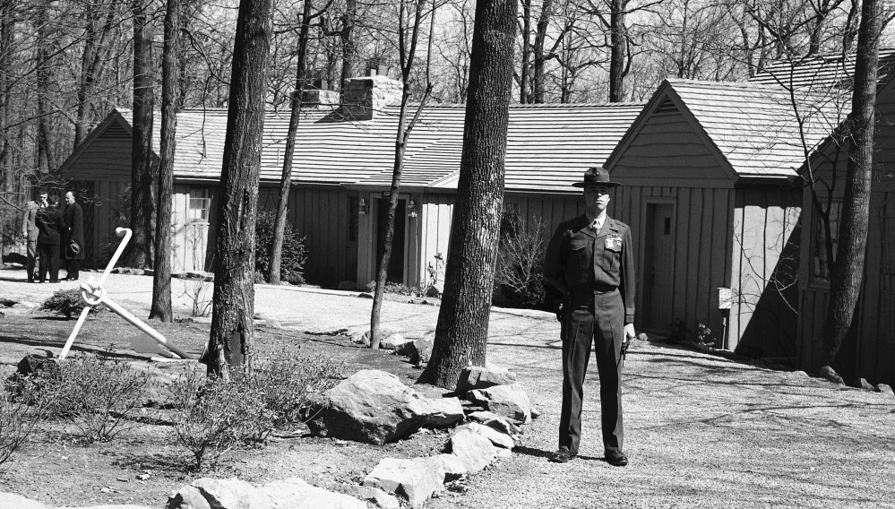 A Marine captain stands guard at Camp David in 1959 during talks between President Dwight Eisenhower and British Prime Minister Harold MacMillan on the Berlin situation.