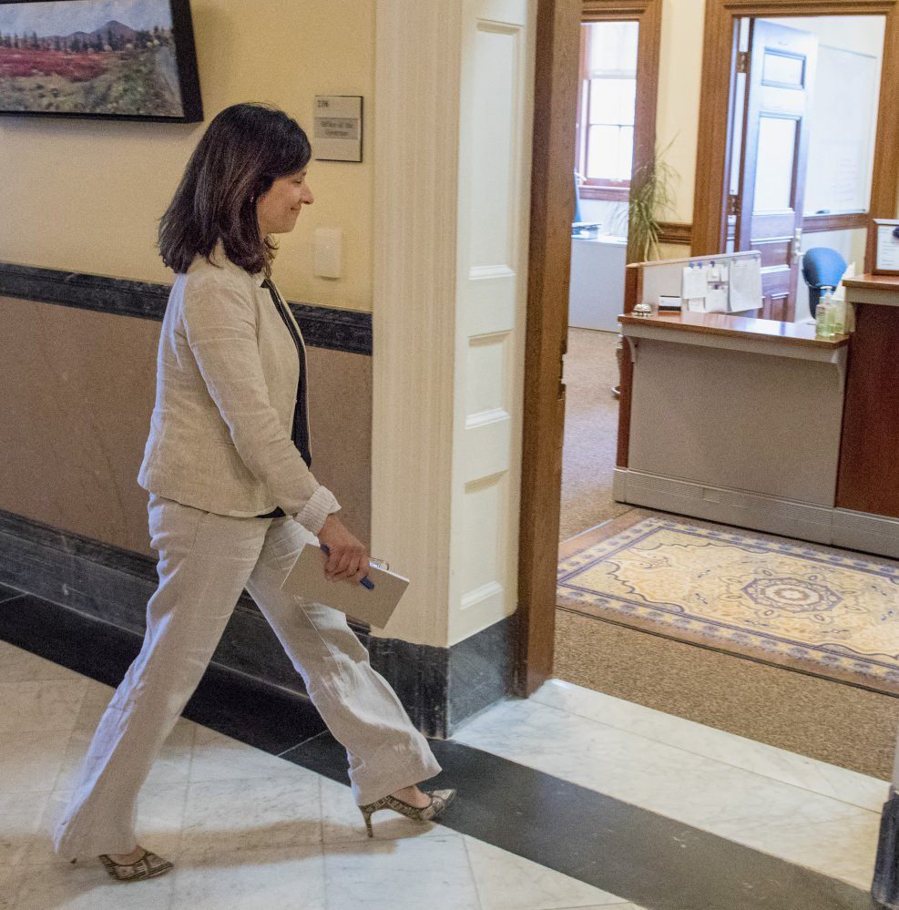 "House Speaker Sara Gideon enters Gov. LePage's office for a meeting on the budget impasse Tuesday. They spoke privately for about 45 minutes. Asked afterward how far apart the sides are, Gideon replied, ""The same."""