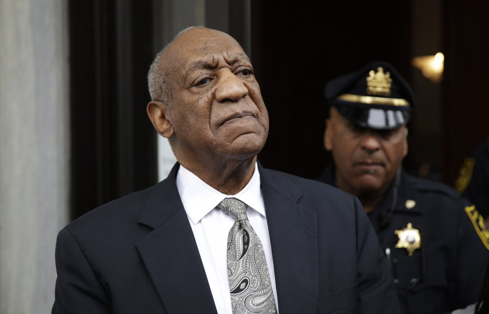 Bill Cosby exits the Montgomery County Courthouse after a mistrial was declared in his sexual assault trial in Norristown, Pa.