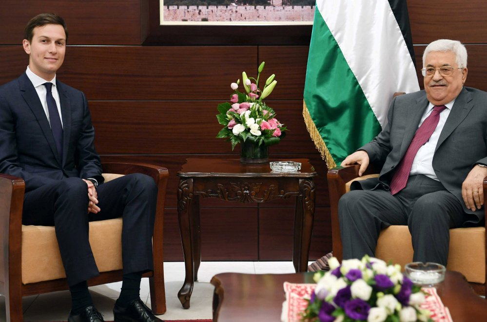 Palestinian President Mahmoud Abbas, right, meets with White House senior advisor Jared Kushner in the West Bank city of Ramallah on Wednesday.