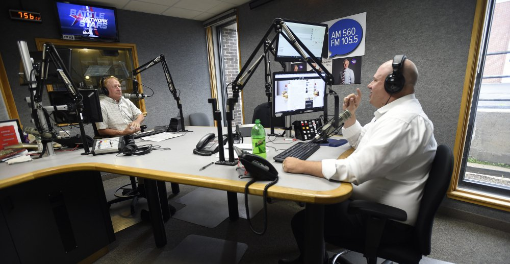 "WGAN's ""Morning News"" hosts Ken Altshuler, left and Matt Gagnon spar on the air Friday in the station's South Portland studio. The political discourse on the show, punctuated with sound effects and banter about pop culture, has alienated some longtime listeners of the broadcast."