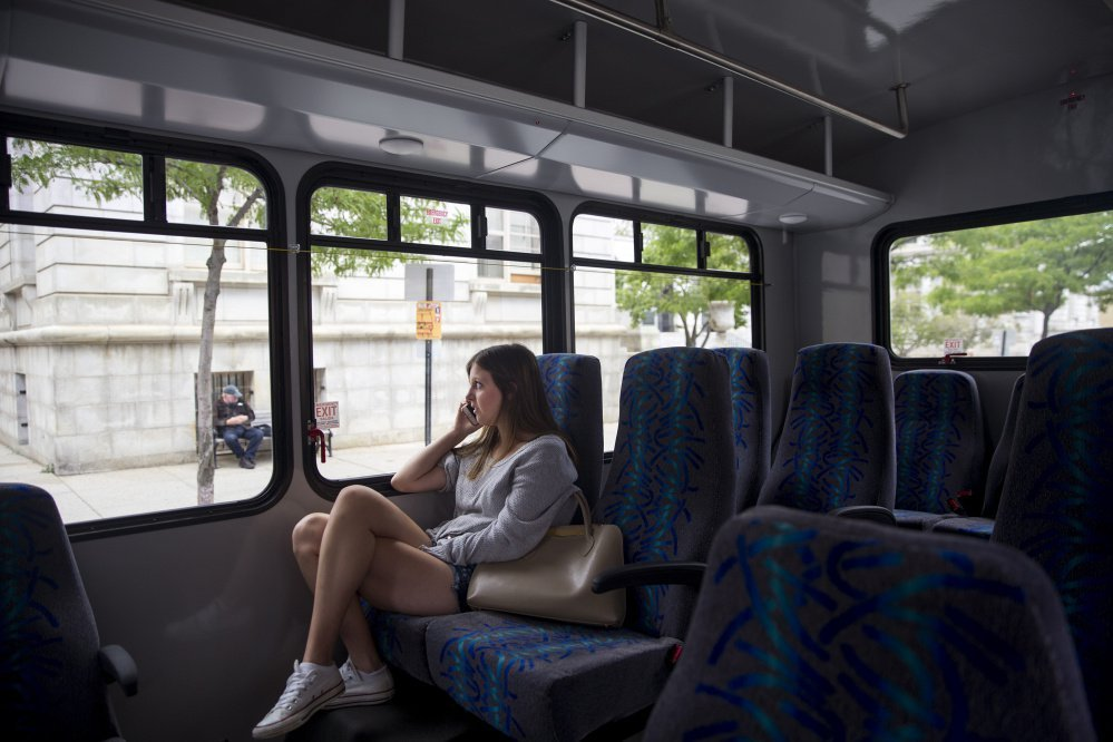 Sarah Perkins rides the Metro Breez bus from Freeport to Portland on Monday.