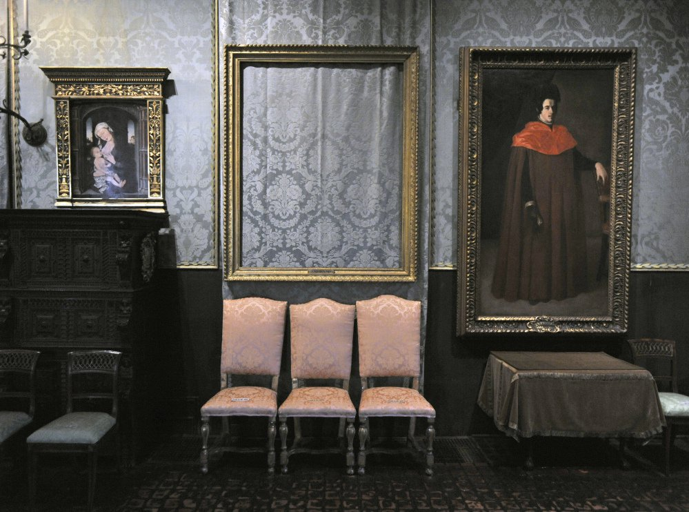 "The empty frame, center, from which thieves cut Rembrandt's ""Storm on the Sea of Galilee"" remains on display at the Isabella Stewart Gardner Museum in Boston."