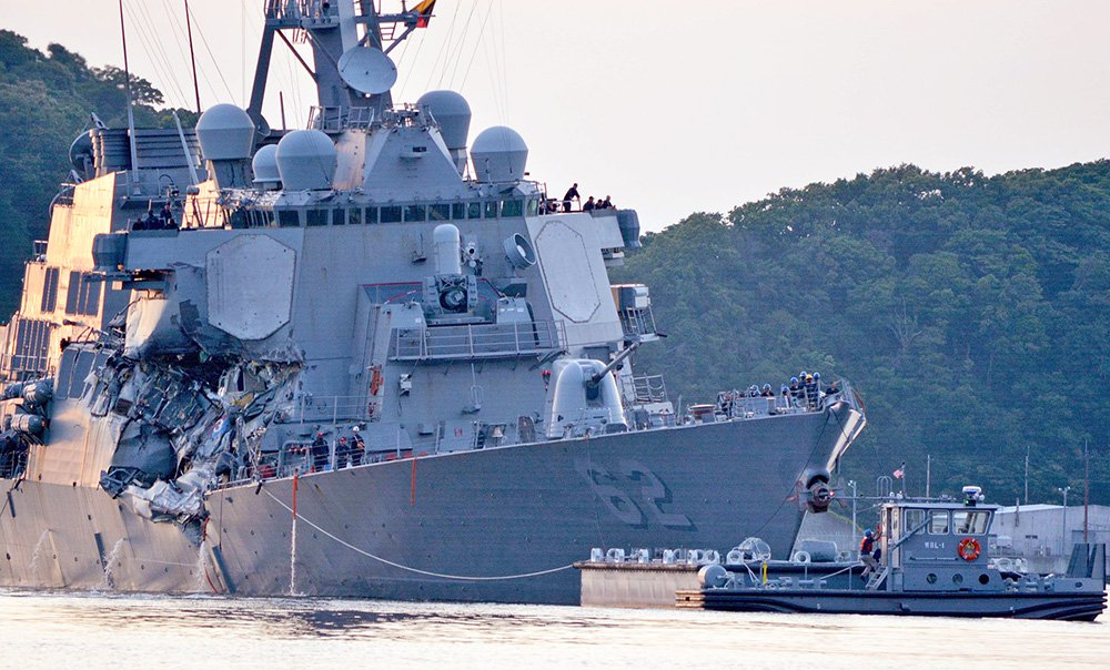 The USS Fitzgerald (DDG 62) returns to base following the collision with a cargo ship while operating southwest of Yokosuka, Japan.