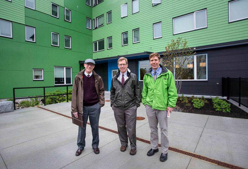 Avesta Housing and Portland Housing Authority unveil a new 45-unit apartment complex on East Oxford Street on Tuesday. Left to right, Mark Adelson, executive director of the housing authority, Dana Totman, CEO/president of Avesta Housing, and Jay Waterman, development director of the housing authority.