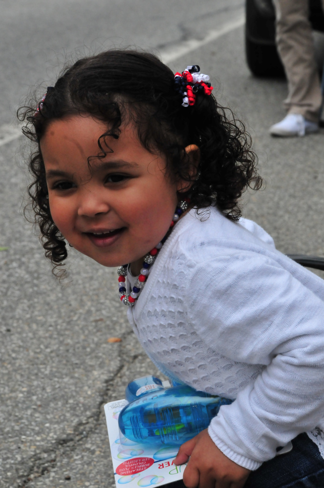 Sophia Carlson, 3, of Gardiner, watched the Gardiner Memorial Day Parade Monday.