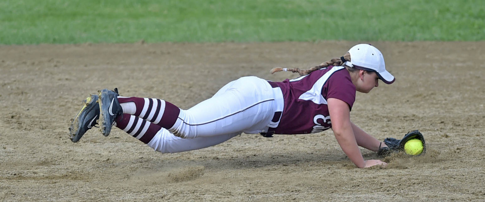 Edward Little's Taylor Depot makes a diving stop on a grounder against Skowhegan during the Kennebec Valley Athletic Conference Class A title game Friday.
