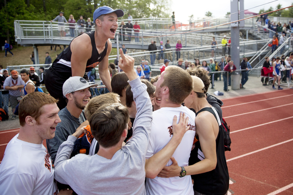 Winslow High School student celebrate after the boys track and field team won the Class B state championship Saturday at Yarmouth High School.