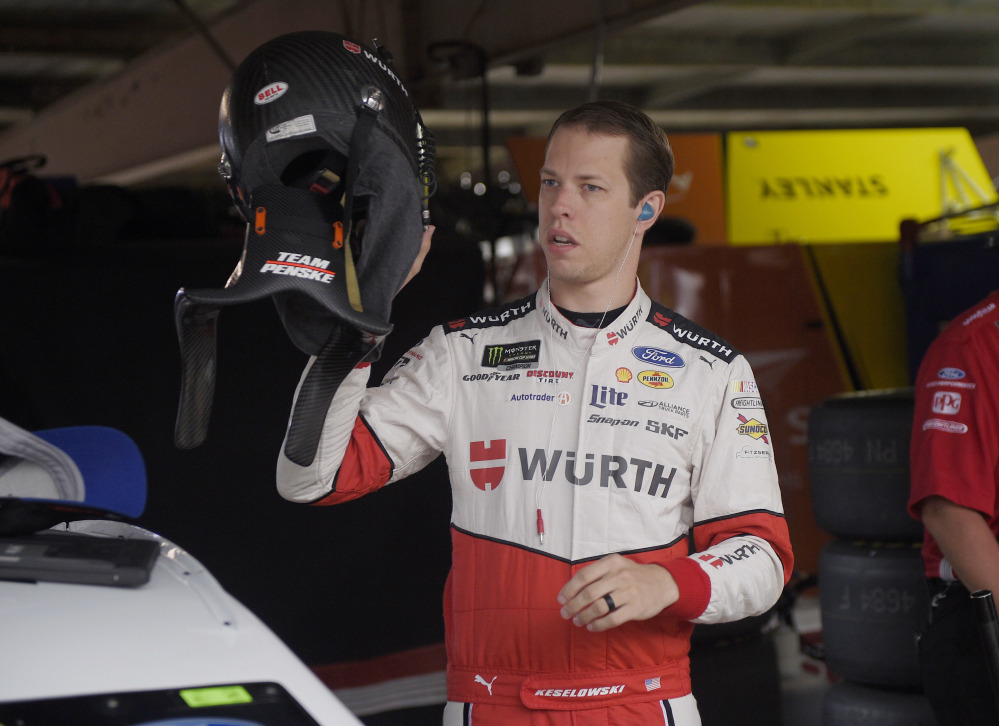 Brad Keselowski gets ready before practice for the NASCAR Cup series race Saturday at Dover International Speedway.