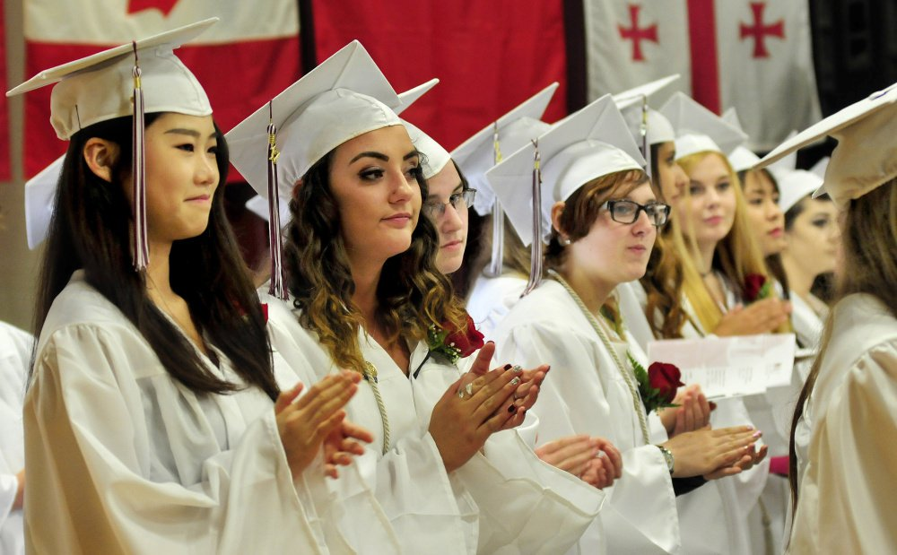 321594f9cdd Delaney Keithley takes a selfie with some of classmates before Cony High  graduation Sunday at Augusta Civic Center. Staff photo by Joe Phelan