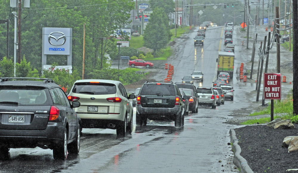 This photo taken on July 16, 2014 shows eastbound Western Avenue traffic near the intersection of Woodside Street in Augusta, where Karen Nightingale, 53, hit a large pothole, crashed her motorcycle, and died of her injuries nine days later.