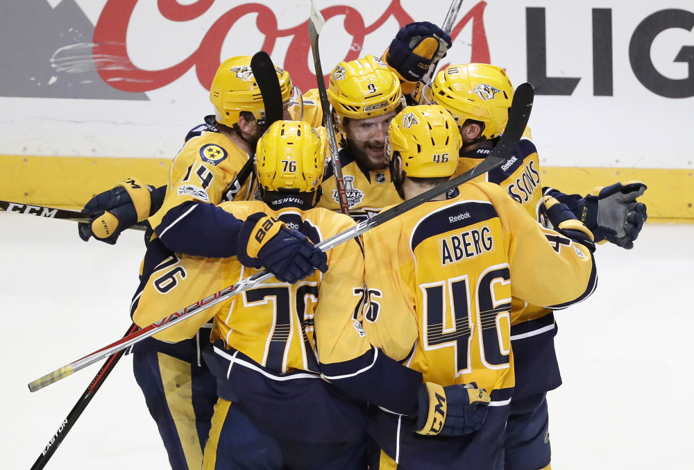 Nashville Predators left wing Filip Forsberg (9) is congratulated after scoring an empty net goal against the Penguins during the third period in Game 4 of the Stanley Cup Final on Monday.