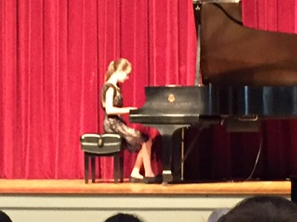 Karin Zimba, a sixth grader at Waterville Junior High School, at the piano during the May 6 Pine Tree Piano Festival. She won first place in the Late ELementary Division.