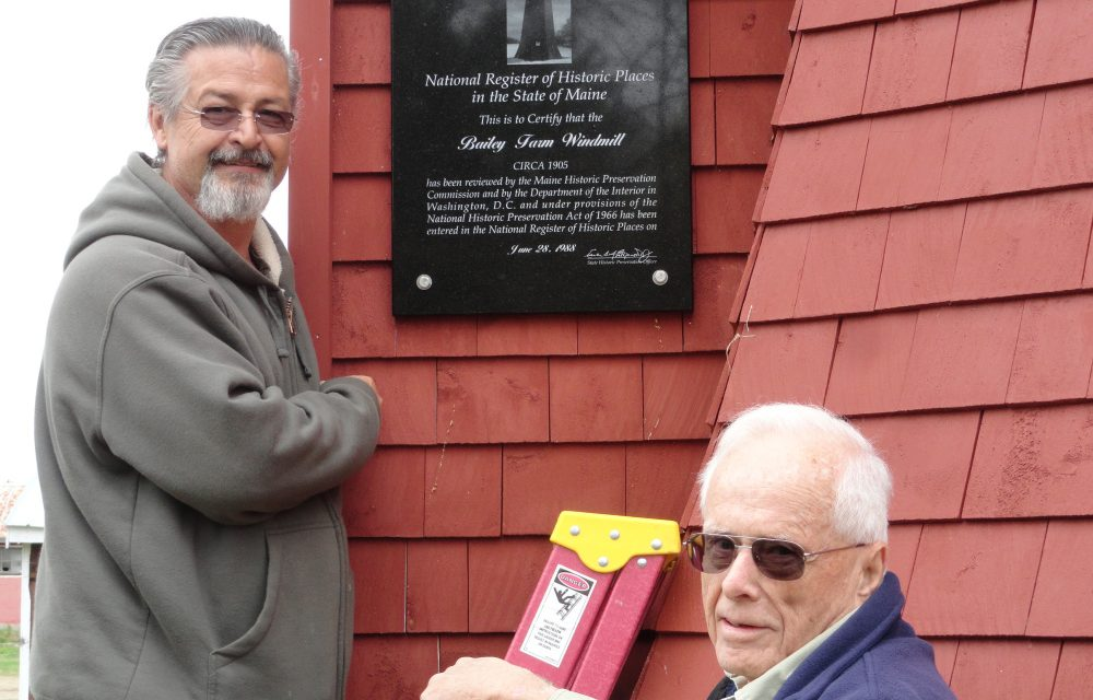 Stan Quint, left, and Mitchell Quint installed a plaque about the historic Bailey Farm Windmill on May 12 at the North Anson windmill.