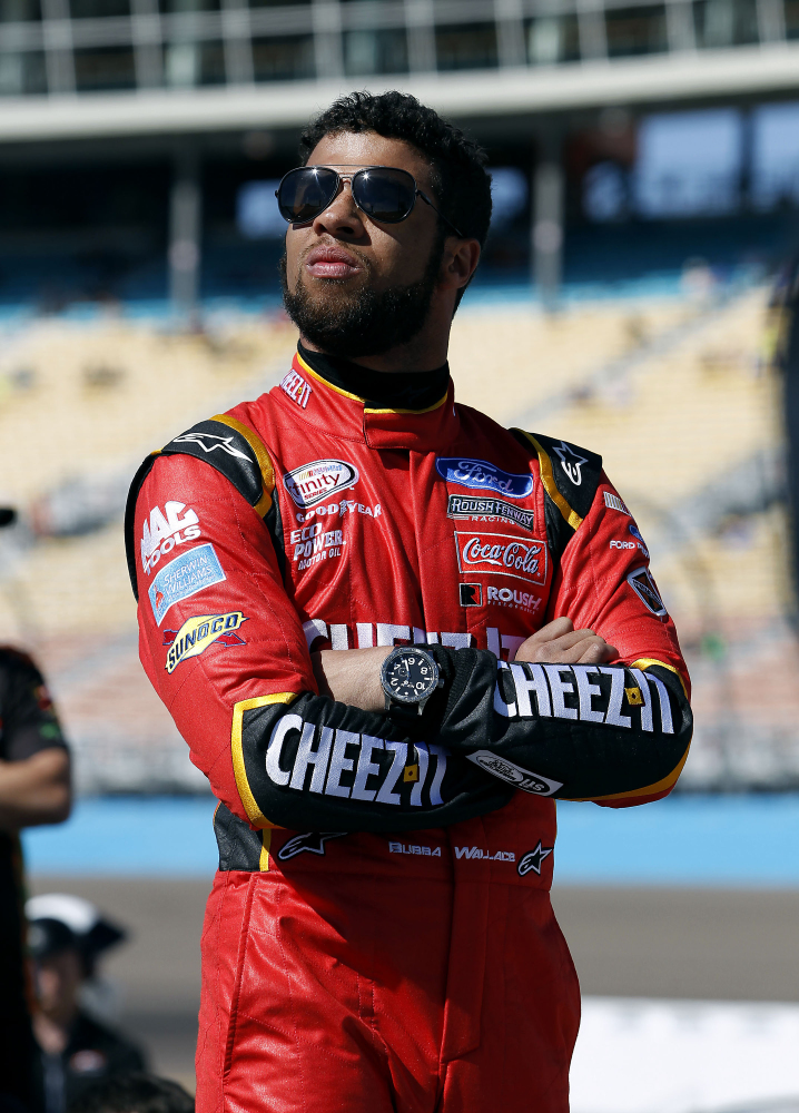 In this March 12, 2016, file photo, Darrell Wallace Jr. looks on from pit road during NASCAR Xfinity Series qualifying at Phoenix International Raceway in Avondale, Arizona.