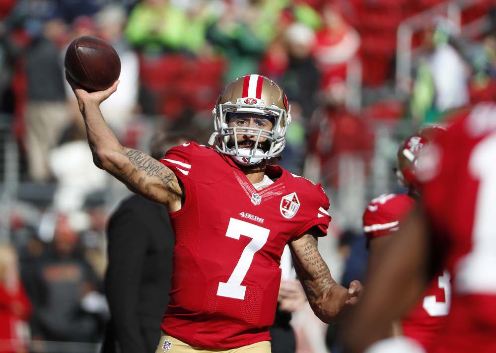 In this Jan. 1 photo, 49ers quarterback Colin Kaepernick warms up before a game against the Seahawks in Santa Clara, California